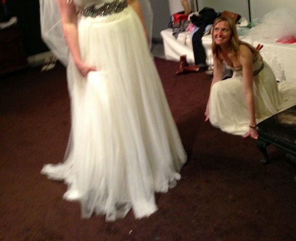 At L'atelier Bridal trying on dresses.